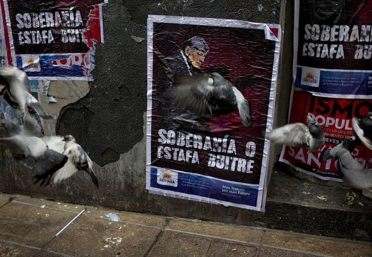 Acreedores estadounidenses reclaman a Argentina el pago de unos mil 500 millones de dólares que el país se niega a cumplir. (AP)