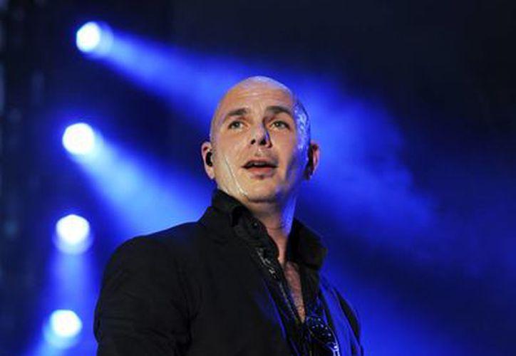 """""""Me siento realmente honrado de estar presentando los '2013 American Music Awards'"""", dijo el rapero de Miami mediante un comunicado. (Agencias)"""