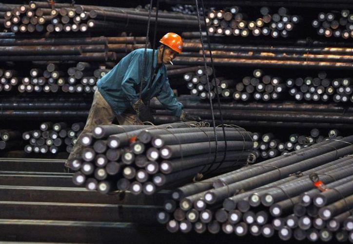 El sector del acero se vio un poco afectado después de que la producción de autos fabricados en México aumentó dos por ciento en 2016. (Archivo/Agencias)