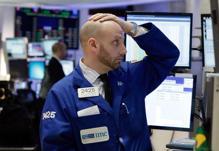 Los futuros del Dow Jones acumulaban a las 23:00 hora de Nueva York una caída de casi 750 puntos. (Archivo AP)