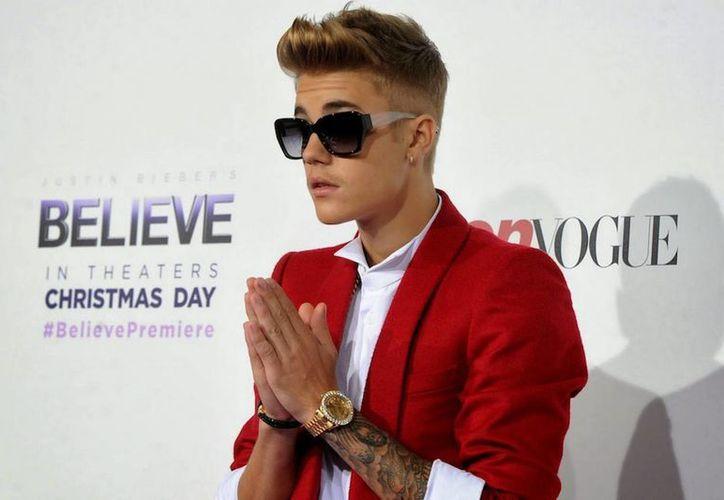 Extienden el tiempo a Justin Bieber para cumplir su servicio comunitario. En la foto, durante la premier del filme 'Believe'. (mas23tv.com)