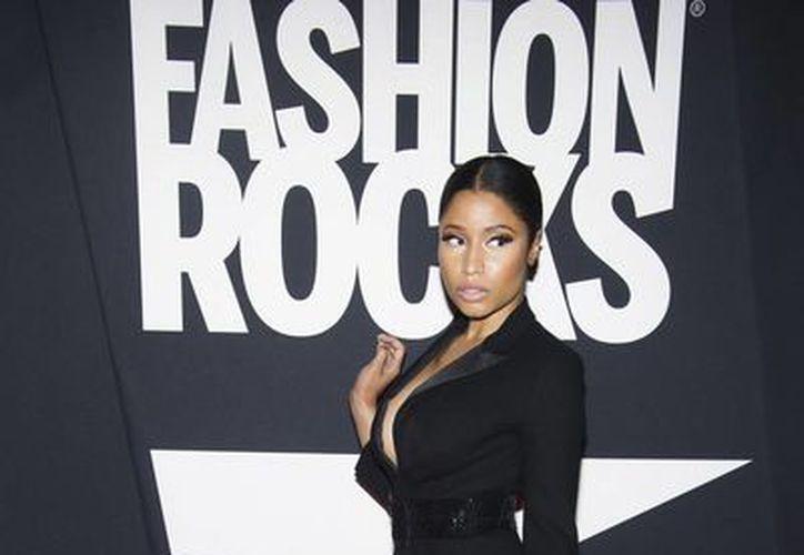 Nicki Minaj parece haberse cansado de utilizar pelucas y ha vuelto a su aspecto anterior. (Foto: AP)
