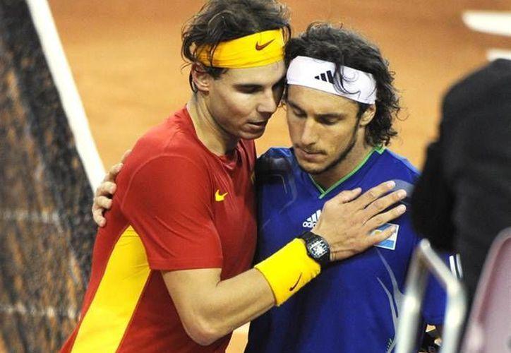 Rafael Nadal con Juan Mónaco. Ambos ganaron en dobles en el Abierto de Qatar. (daviscup.com/Foto de archivo)