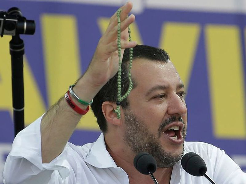 Matteo Salvini holds a rosary on stage during the traditional League party rally in Pontida, northern Italy, Sunday, July 1, 2018.