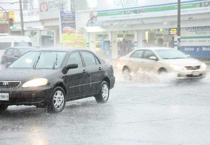 Conagua pronosticó lluvias intensas para toda la Península de Yucatán. La imagen corresponde al aguacero del martes pasado, en Mérida. (Jorge Acosta/Milenio Novedades)