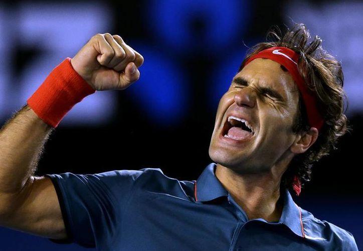 Roger Federer celebra su triunfo frente a Andy Murray, en el Abierto de Australia. El suizo mantiene su hegemonía sobre el inglés en partidos de torneos de <i>Grand Slam</i>.