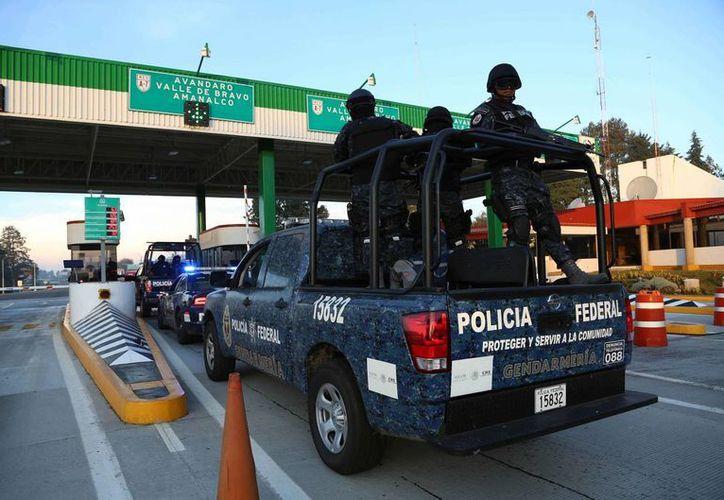 Las autoridades indicaron que han golpeado la estructura de células delictivas en el Estado de México con el aseguramiento de cientos de vehículos. (Archivo/Notimex)