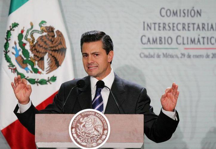 Peña Nieto asistió a la clausura de la Segunda Reunión Plenaria de los diputados del PRI y el PVEM. (Archivo/Notimex)