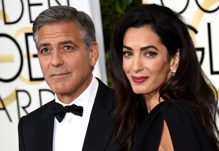 """Clooney agregó que los fotógrafos, la agencia de fotos y la revista enfrentarán acciones legales porque la seguridad de sus hijos """"lo exige"""". (Multimedios)"""