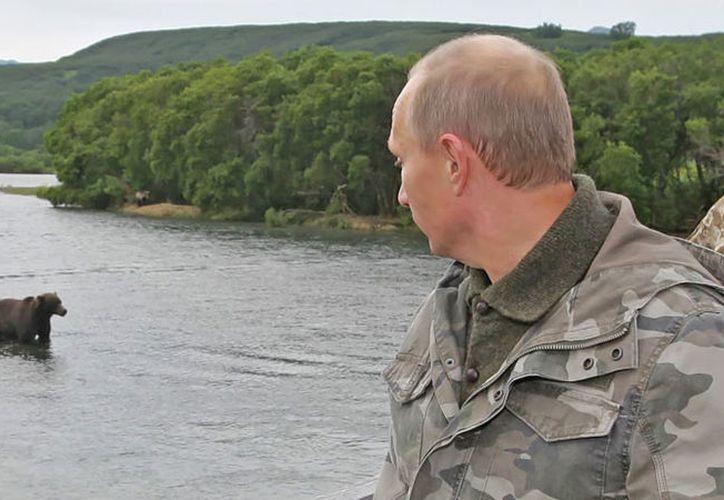 El presidente de pesca se encontraba de pesca. (ALEXEY DRUZHININ / RIA NOVOSTI / AFP)
