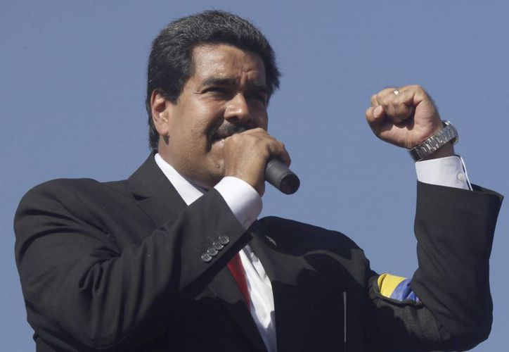 Nicolás Maduro asumió la presidencia de facto luego de que Hugo Chávez se trasladó a Cuba para atenderse del cáncer.  (AP)