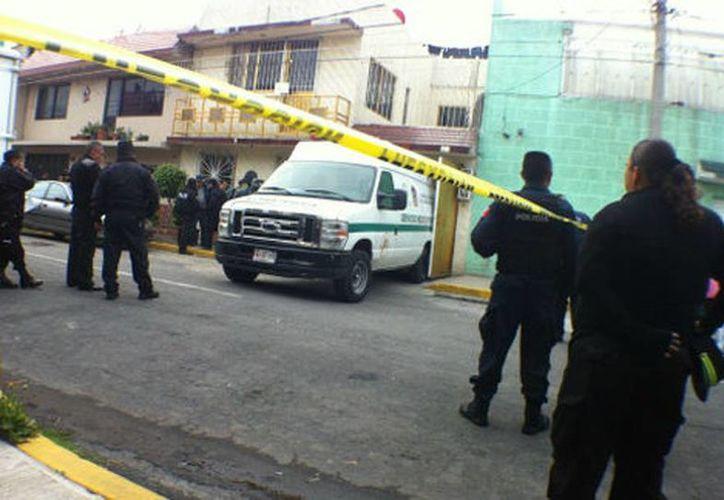 Los cuerpos fueron trasladados por el Servicio Médico Forense a la agencia del Ministerio Público. (Juan Gabriel Ortega/Milenio)