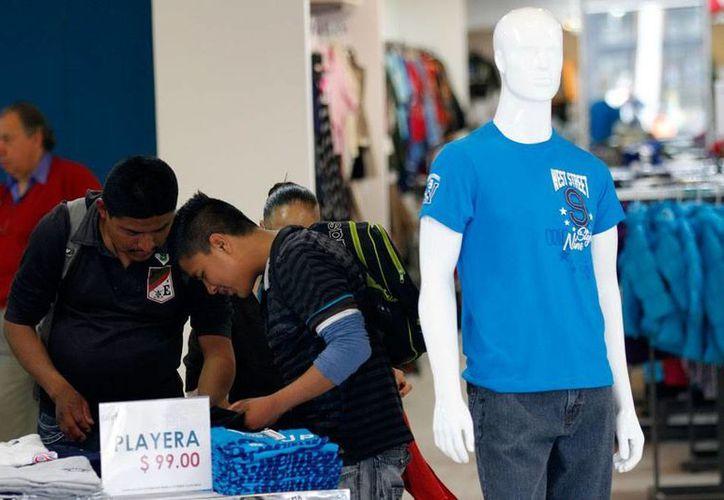 En el primer año de El Buen Fin, en 2011, el mayor volumen de ventas se dio en electrónicos, ropa y calzado; en total, las ventas superaron los 100 mil mdp. Este 2014, los comerciantes van por el doble: 200 mil mdp. Imagen de contexto. (NTX/Archivo)