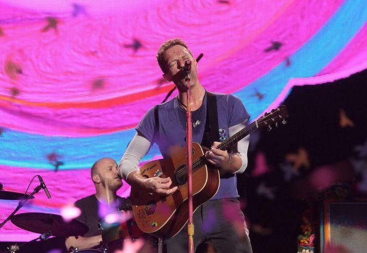 Coldplay presentó con éxito el primero de tres conciertos programados en el Foro Sol, como parte de su gira 'A head full of dreams'.(Notimex)