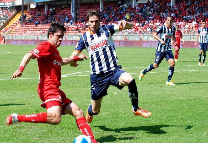 Diablos Rojos mantuvo su racha invicta al salir vencedor del partido ante Monterrey, en la jornada 4 del Clausura 2014. (Notimex)
