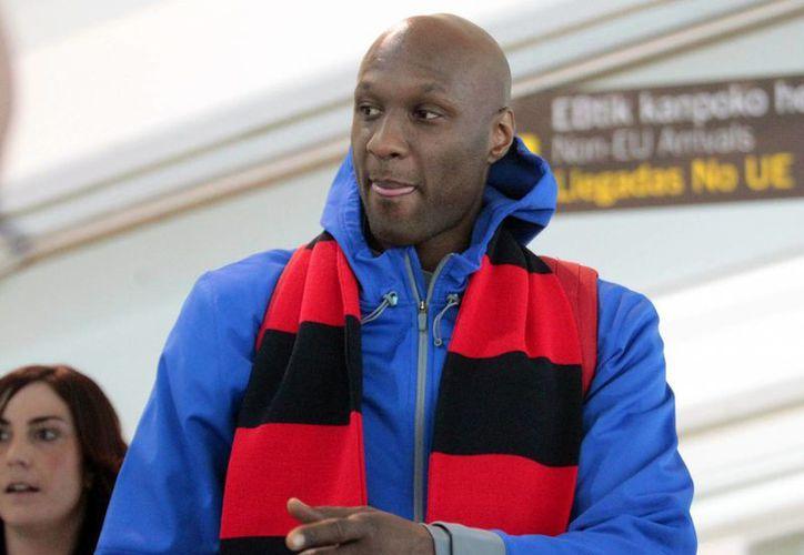 Lamar Odom, el exbasquetbolista de NBA que hace unos días fue hallado inconsciente en un burdel, estaba en estado crítico pero ahora ya respira. (EFE)