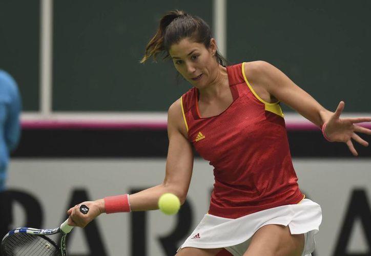 Garbiñe Muguruza, número siete del mundo, quedó eliminada en la segunda ronda del torneo de tenis Femenil de Doha, Qatar.(Jaroslav Ozana/AP)