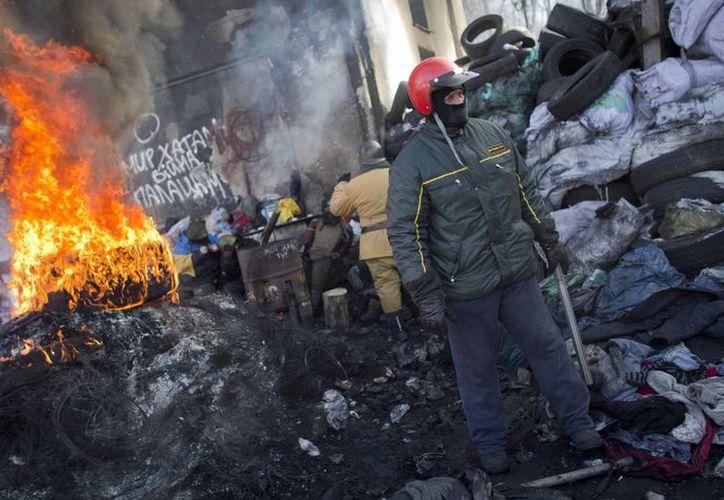 Las movilizaciones han paralizado la capital Kiev y se han extendido a otras ciudades. (Agencias)