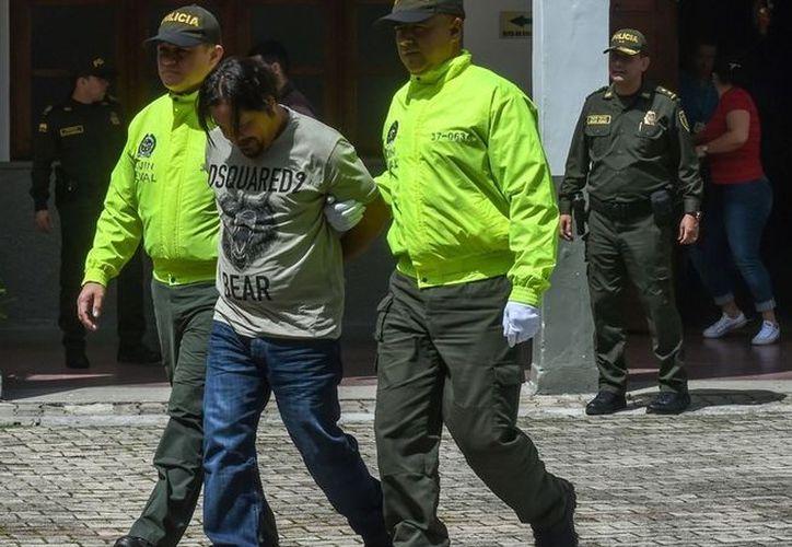 """Detención del capo Juan Carlos Mesa Vallejo, conocido como """"Tom"""". (Foto: AFP)"""