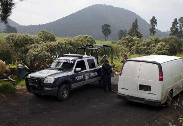 Fueron 13 los jóvenes hombres y mujeres raptados en un bar del DF, ejecutados y hallados en una fosa en Tlalmanalco, en un rancho (foto) del Estado de México bajo circunstancias que aún se investigan. (Notimex)