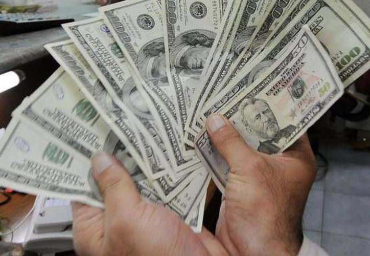 La divisa estadounidense se compró en un mínimo de $14.07. (Archivo/AP)