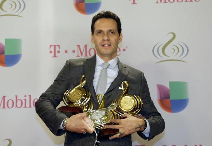 Marc Anthony logró los premios a disco del año, canción del año y artista tropical del año. (Agencias)