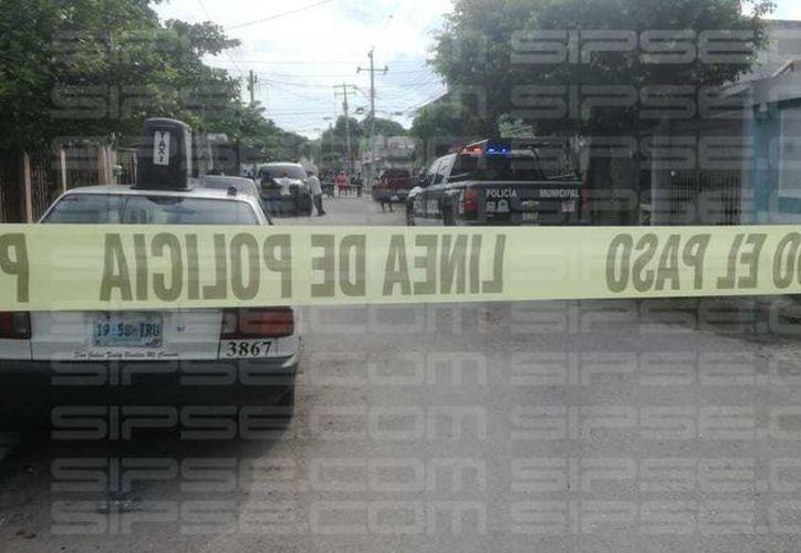 Una hombre fue encontrado hoy dentro de una vivienda sin vida y con las manos amarradas, en la SM 91. (Orville Peralta/SIPSE)