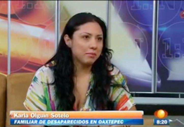 Karla Olguín es hija de una de las mujeres desaparecidas de Oaxtepec, niega que su madre sea invasora de predios y responsabiliza a Perla Recillas de las desapariciones. (Captura de pantalla You tube)