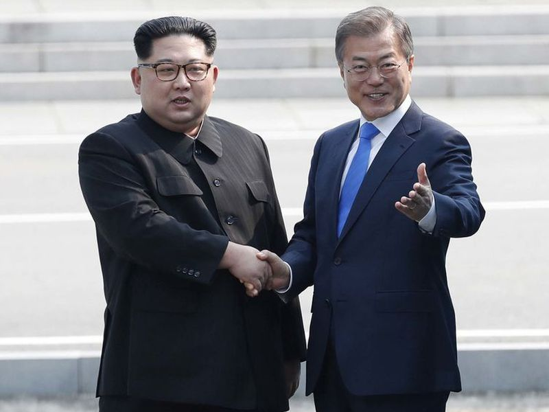 North Korean leader Kim Jong Un, left, shakes hands with South Korean President Moon Jae-in as Kim crossed the border into South Korea for their historic face-to-face talks, in Panmunjom. (AP).