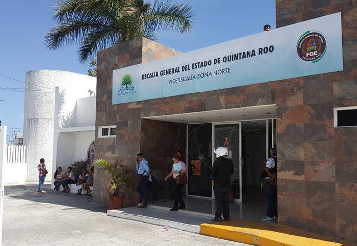 Elementos de la Policía Ministerial continúan con las indagaciones del asalto. (Eric Galindo/SIPSE)