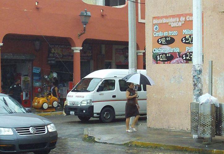 Conagua informa que la lluvia y el fresco en Progreso se prolongarán hasta el miércoles, por lo que se recomienda a la población tomar las precauciones. (Manuel Pool/SIPSE)