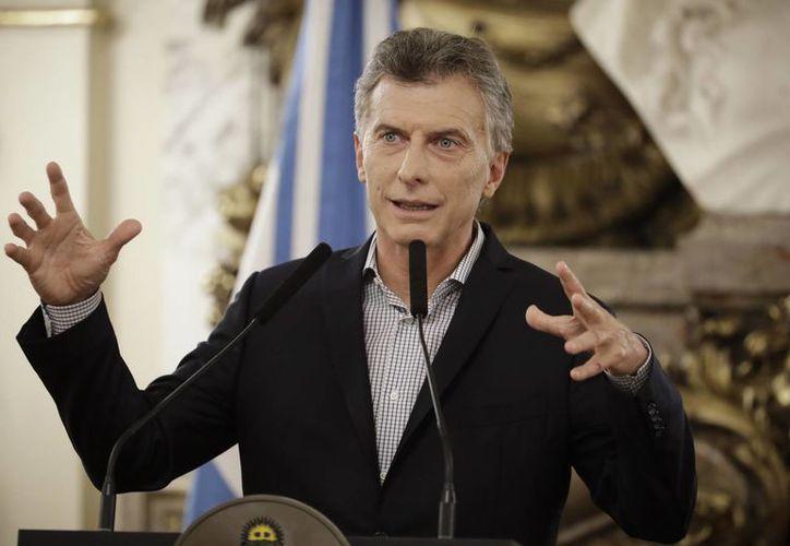 El presidente Mauricio Macri asegura que cuando se equivoca 'pide disculpas' y corrige. (AP/Victor R. Caivano)