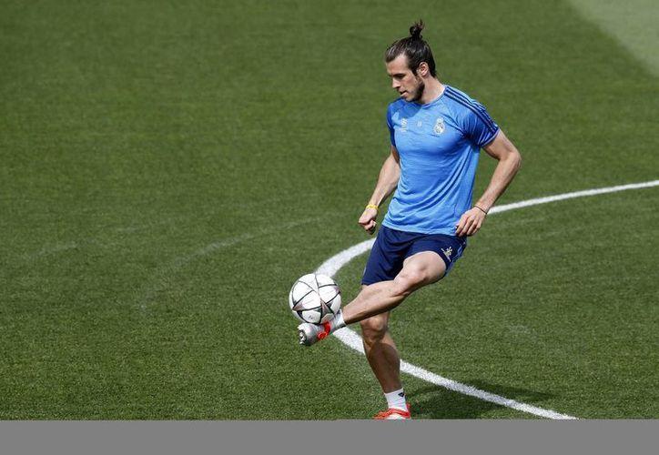 Gareth Bale, titular indiscutible de Real Madrid, es la única gran figura de la selección de Gales, que jugará en Francia su primera Eurocopa desde 1958. (EFE)