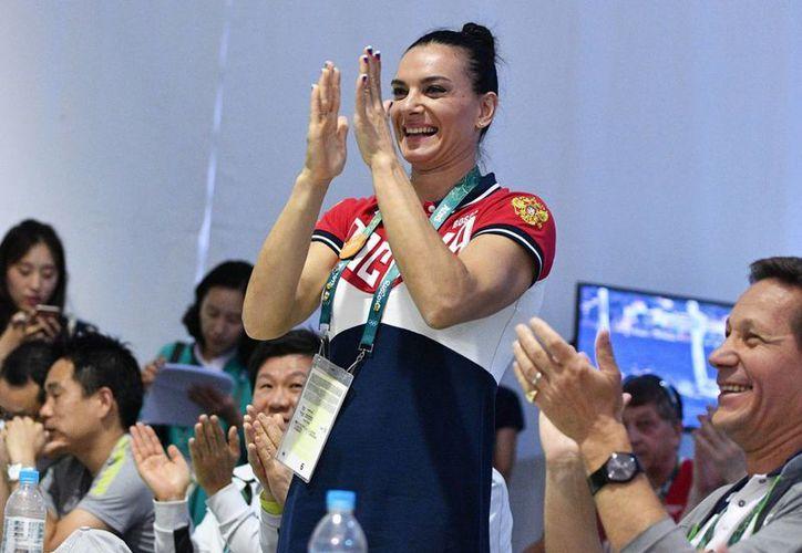 La rusa Yelena Isinbáyeva,  bicampeona olímpica en salto con garrocha, fue elegida juinto con otros tres deportistas para integrar el Comité Olímpico Internacional. (EFE)