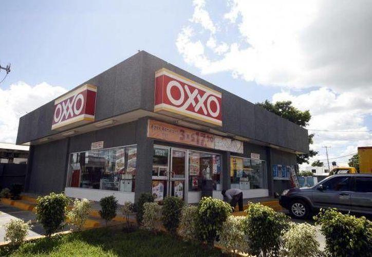 La cadena Oxxo tiene un valor que asciende a más de dos mil millones de dólares. (Archivo/SIPSE)