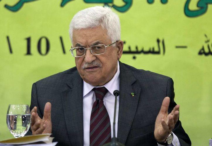 En esta imagen de archivo del 18 de octubre de 2014, el presidente palestino, Mahmud Abás, durante una reunión con el consejo revolucionario de Fatá en la ciudad cisjordana de Ramala. (Agencias)