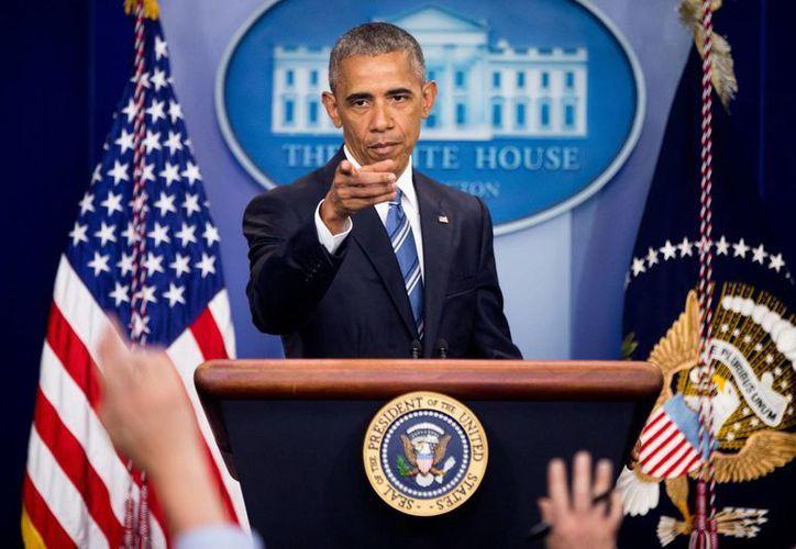 Obama dijo que la deportación de inmigrantes que no son criminales seguirá siendo de prioridad baja. (Agencias)