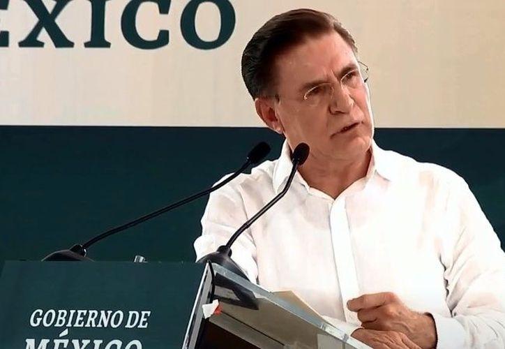 El Gobernador de Durango se lanzó contra algunos manifestantes. (Agencia Reforma)