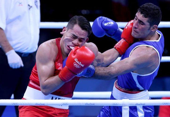 El martes 9 de agosto, Misael Rodríguez (izq) derrotó al iraquí Waheed Karaawi, sellando su pase a los cuartos de final en la modalidad de los 75 kgs. En el marco de los juegos olímpicos Río 2016. (Archivo/Notimex)