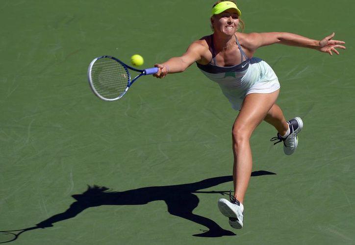 Sharapova despachó 7-5, 6-0 a la española Lara Arruabarrena. (Agencias)