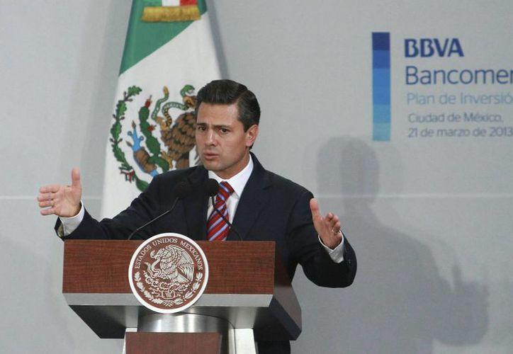 El mandatario encabezó el acto del grupo bancario español. (Archivo/Notimex)