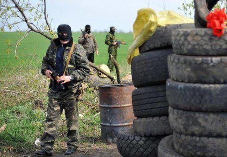 Imagen de algunos integrantes del grupo Sector Derecho. (Archivo/AFP)