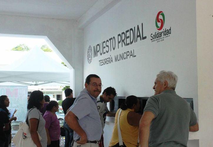 La Tesorería del municipio de Solidaridad reporta que durante 2014 superó sus expectativas en el cobro del impuesto predial. (Daniel Pacheco/SIPSE)