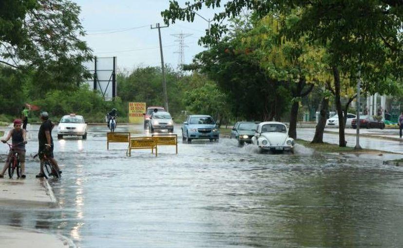 Debido a la baja presión y una nueva onda tropical se esperan chubascos sobre la Península de Yucatán para los próximos días. (Archivo/ Milenio Novedades)
