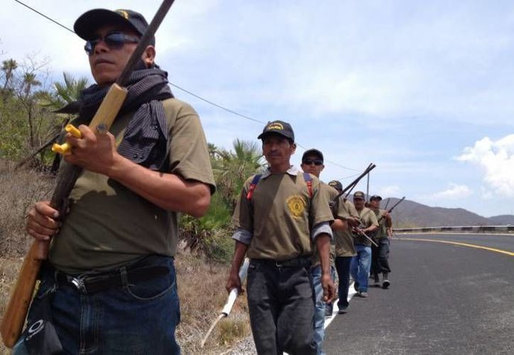 Aún se investiga si los grupos de autodefensa están implicados en el ataque a manifestantes de mitin. (Notimex/Archivo)