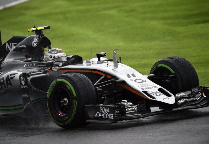 La lluvia complicó los entrenamientos de la escudería Force India y, en particular, del piloto mexicano de Fórmula Uno, Sergio 'Checo' Pérez, rumbo al Gran Premio de Japón que se realizará este domingo. (EFE)