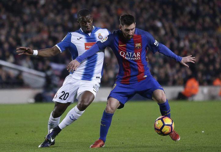 Lionel Messi forma parte del once ideal de la UEFA, luego de conquistar la Liga de España y la Copa del Rey con el Barcelona.(Manu Fernandez/AP)