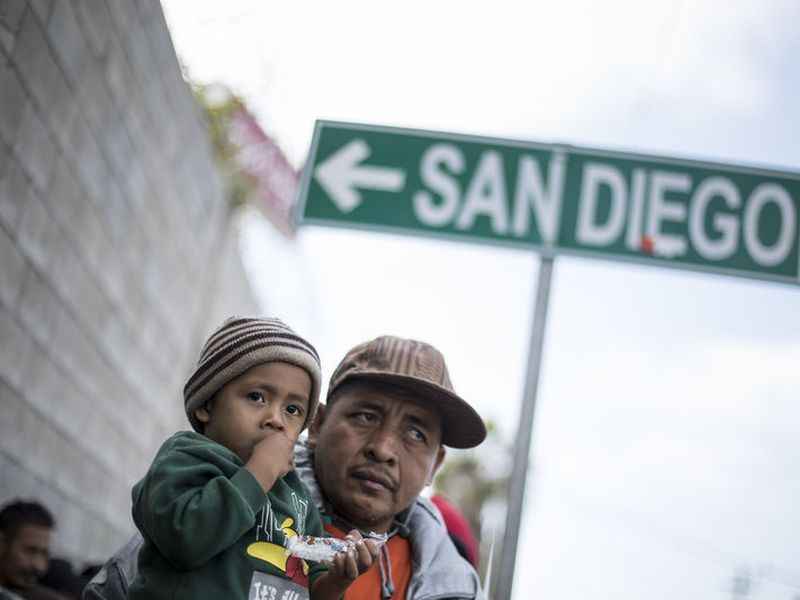 A father and his son await tutorship by immigration lawyers in Tijuana, Mexico.