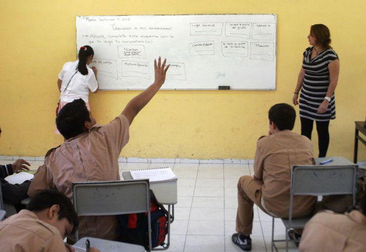 Los docentes recibirán una parte del aguinaldo en este mes y otra en enero. (Foto: Milenio Novedades)