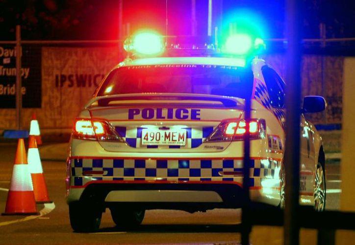 Decenas de policías vigilan el sitio donde se encontraron los cadáveres de varios menores, en Australia. (missoulian.com)